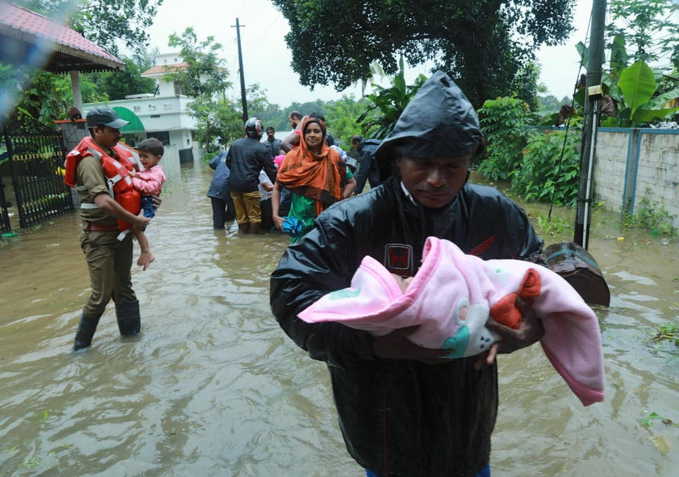 worst floods in nearly a century kill  in indias kerala state  rescue workers evacuate people in muppathadam in kochis ernakulam district