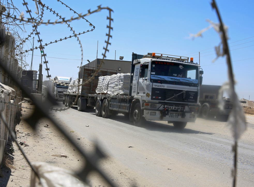 Trucks full of goods depart from the Palestinian side of the Kerem Shalom cargo crossing with Israel in Rafah, southern Gaza Strip, on Wednesday