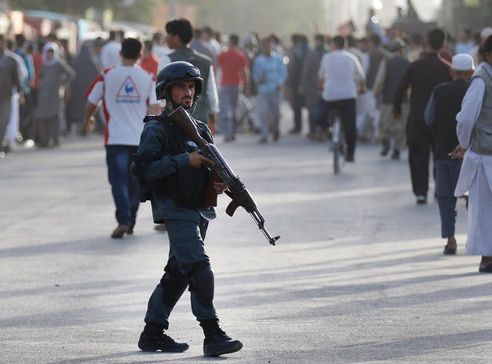 Afghan security patrols at the scene of a suicide attack in Kabul, Afghanistan