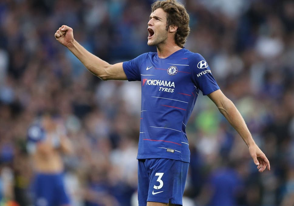 Marcos Alonso cheering after scoring a goal.