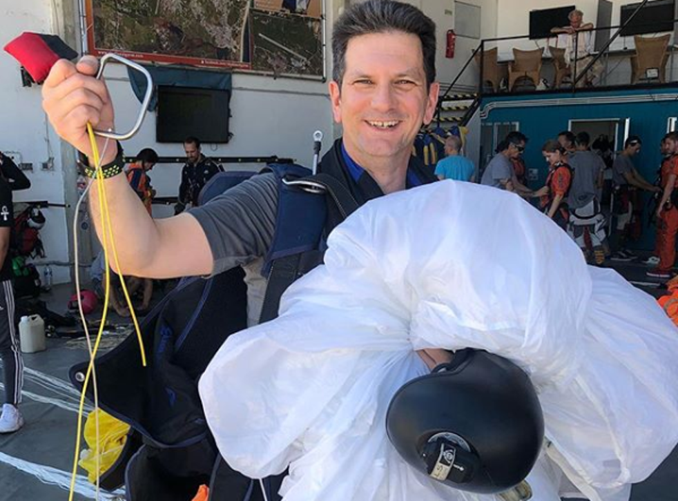 Former Brexit minister poses with reserve parachute he was forced to deploy