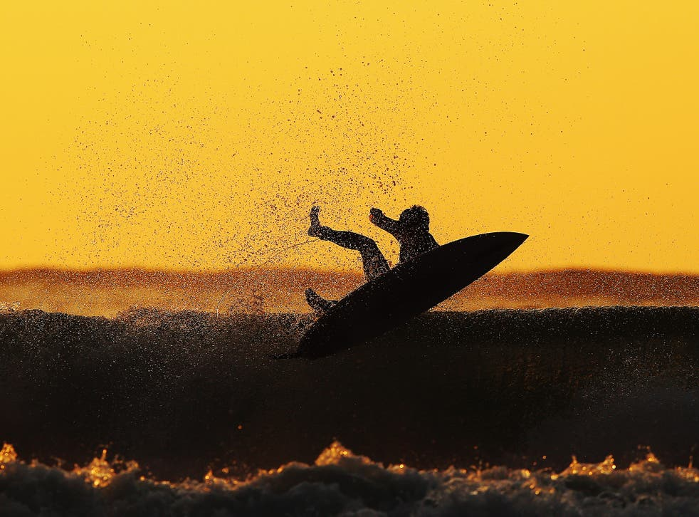 Police say surfers were confronted by two people on the bank, who began shouting abuse at them
