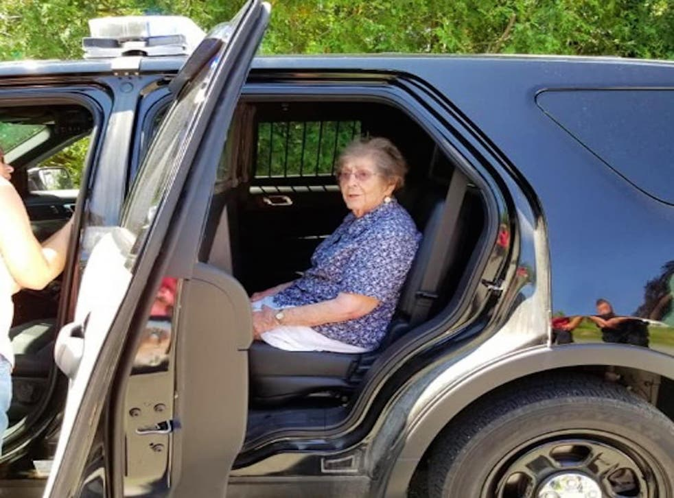 A 93-year-old woman in Maine is taken into a police car to experience a 'gentle arrest' on 9 July 2018