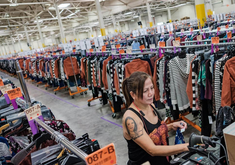 15f637ac7c A Stitch Fix warehouse worker packing and dispatching clothing, chosen for  customers by a combination