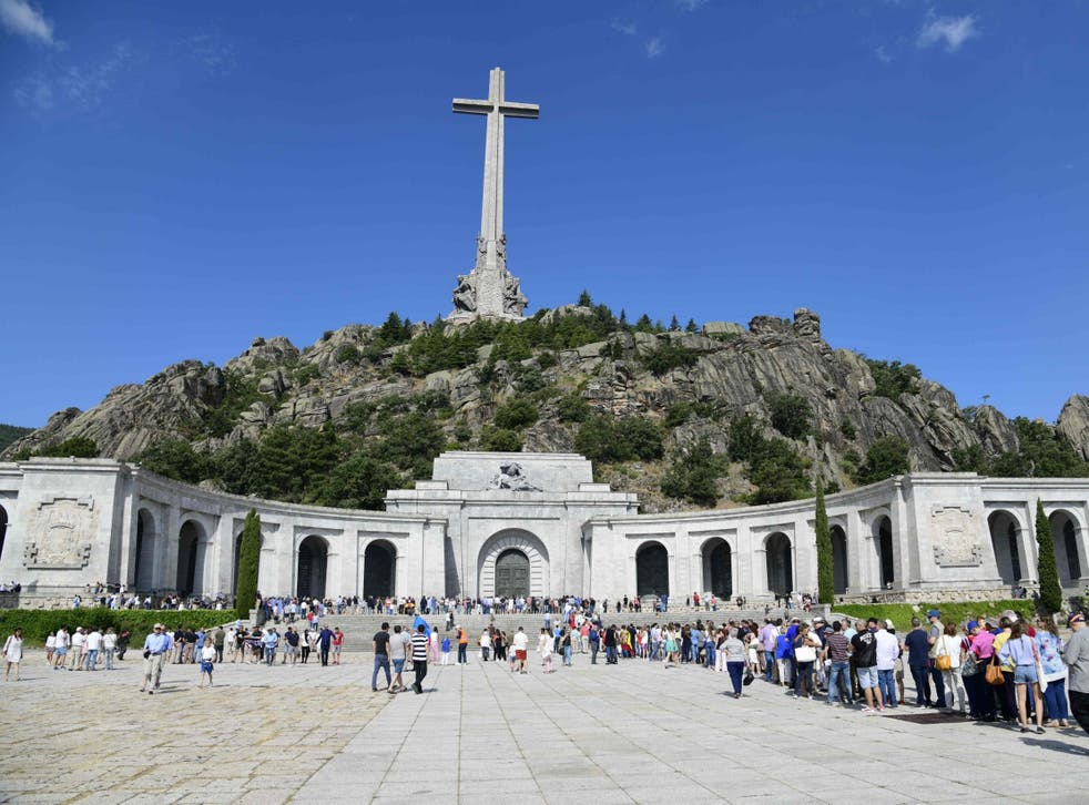Tourists queue to view Franco's tomb in the basilica at the Valley of the Fallen near Madrid