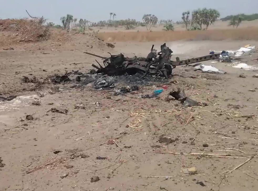The wreck of a vehicle at the scene of an airstrike which allegedly hit a car carrying displaced people, killing women and children fleeing fighting in Al Durayhimi district
