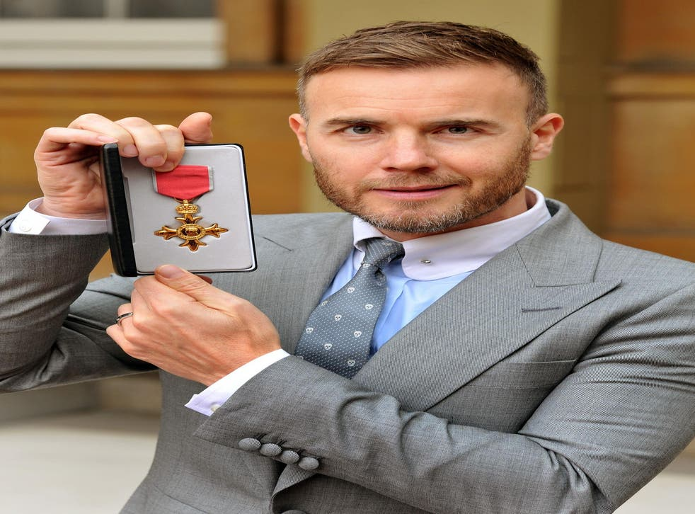 Gary Barlow, who was awarded an OBE for services to the entertainment industry and to charity