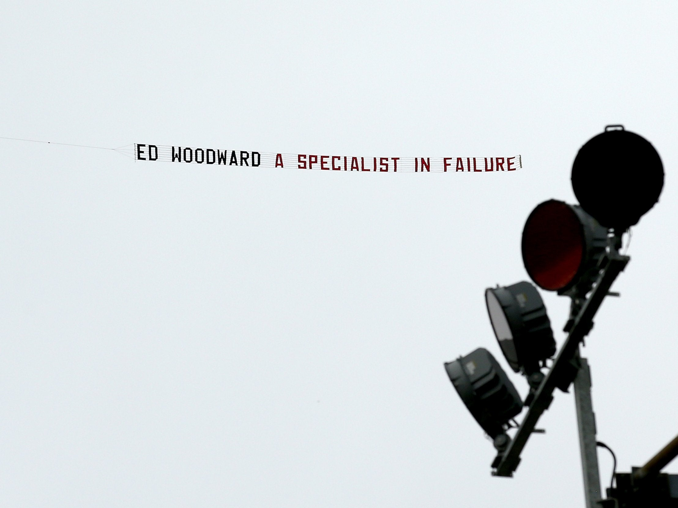 manchester united fans fly ed woodward banner over burnley match