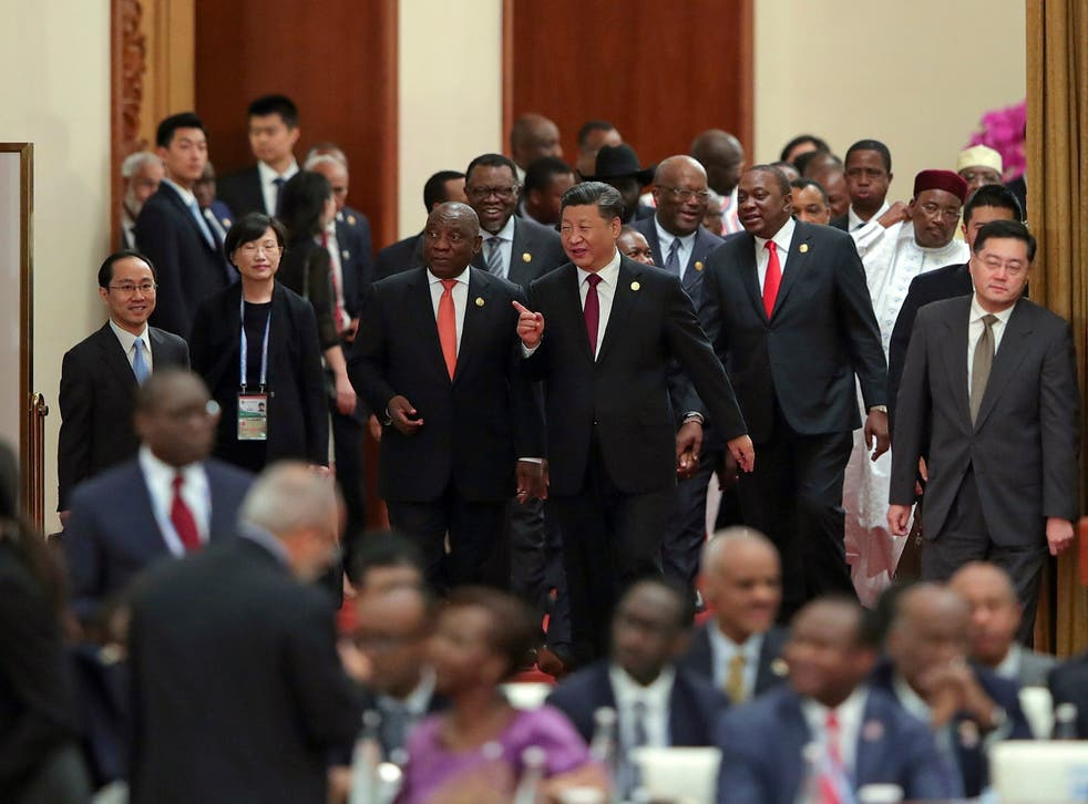 Chinese president Xi Jinping, centre, with South Africa's Cyril Ramaphosa, centre left, and other leaders behind, attend the 2018 Beijing FOCAC summit