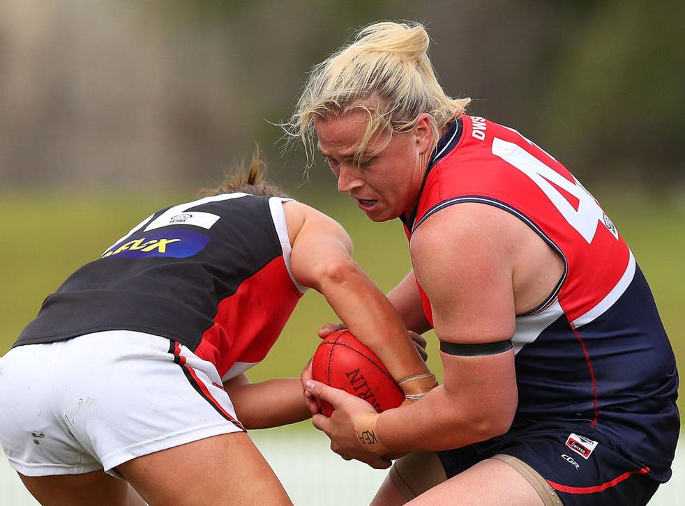 Hannah Mouncey (right) has withdrawn from the 2019 AFLW Draft and accused officials of blocking her from playing