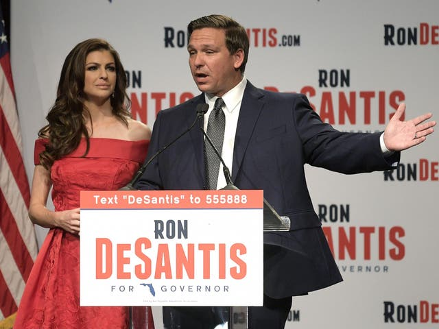 Florida Republican gubernatorial candidate Ron DeSantis, right, speaks to supporters with his wife, Casey, at an election party after winning the Republican primary
