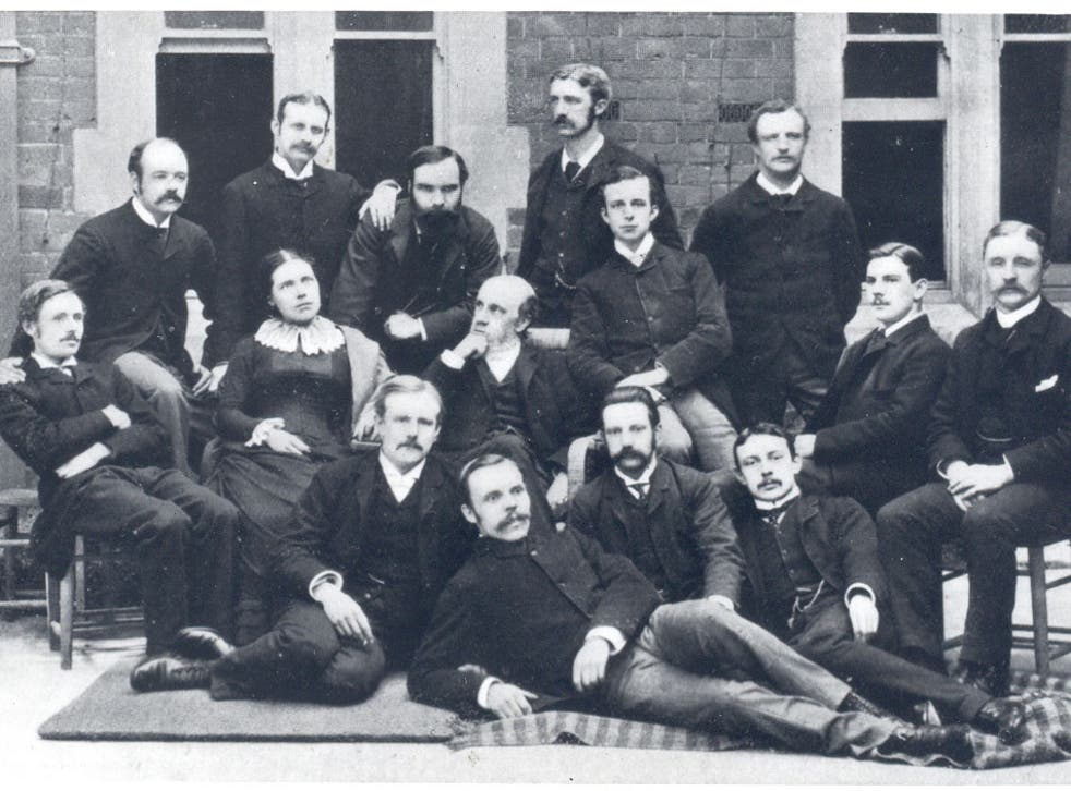 The early residents of Toynbee Hall, with Rev Samuel Barnett sitting to the right of his wife Henrietta