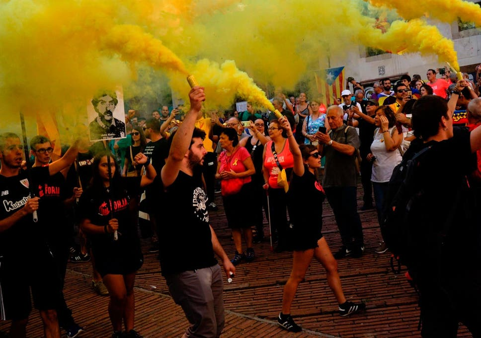 Independence demonstrators march during 'Diada' in Barcelona, where Catalonians are seeking independence from Spain