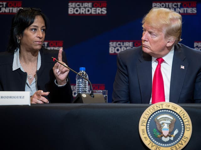 Evelyn Rodriguez speaks alongside Donald Trump during a roundtable discussion on immigration in New York in May 2018