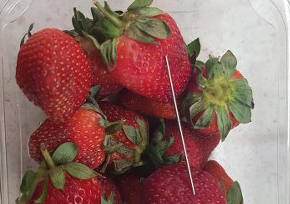 A thin piece of metal seen among a basket of strawberries in Queensland
