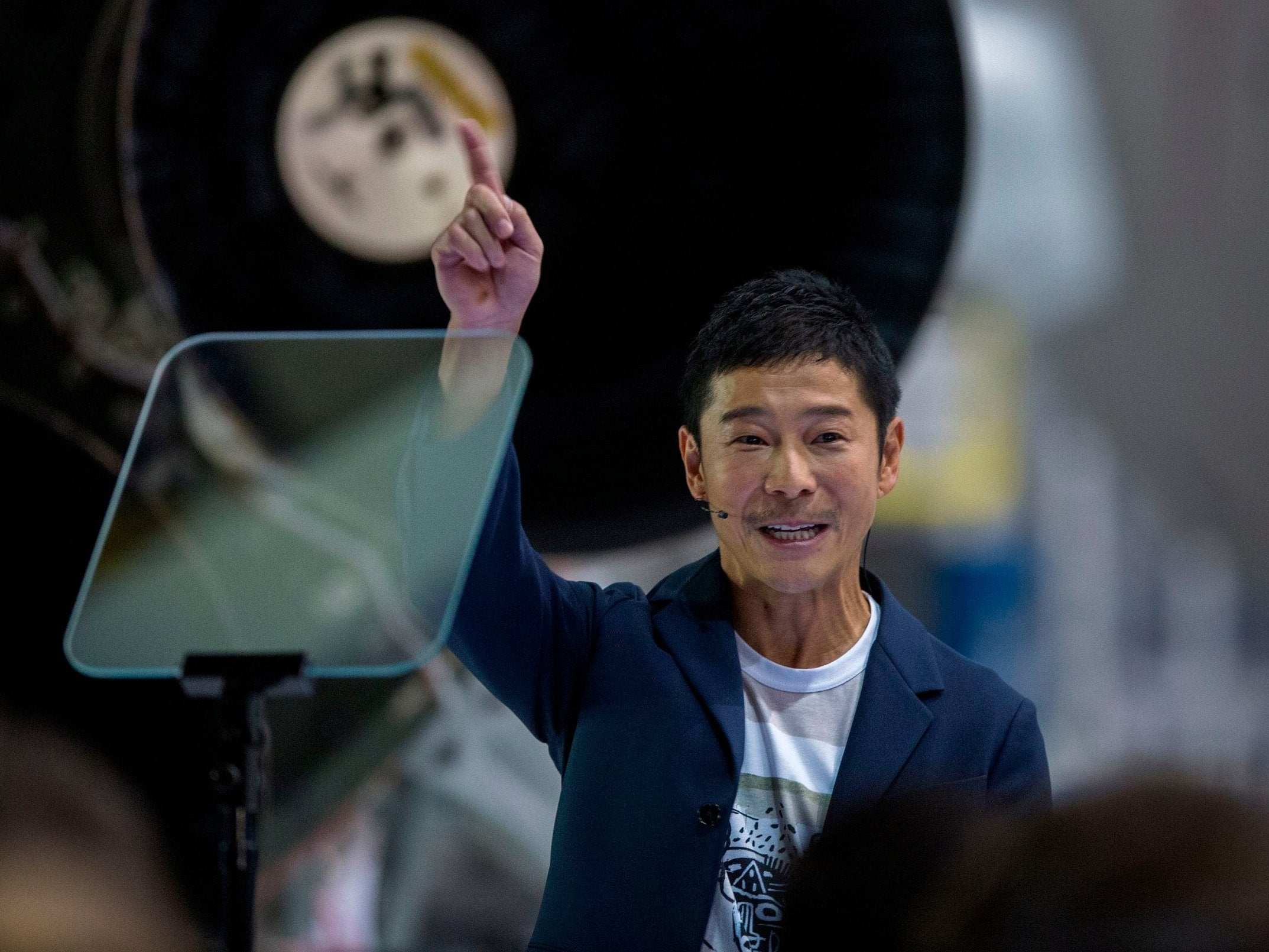 Japanese billionaire Yusaku Maezawa at his unveiling in Hawthorne, California, as the first private passenger to fly around the moon aboard the SpaceX Big Falcon Rocket ( David McNew/AFP/Getty )