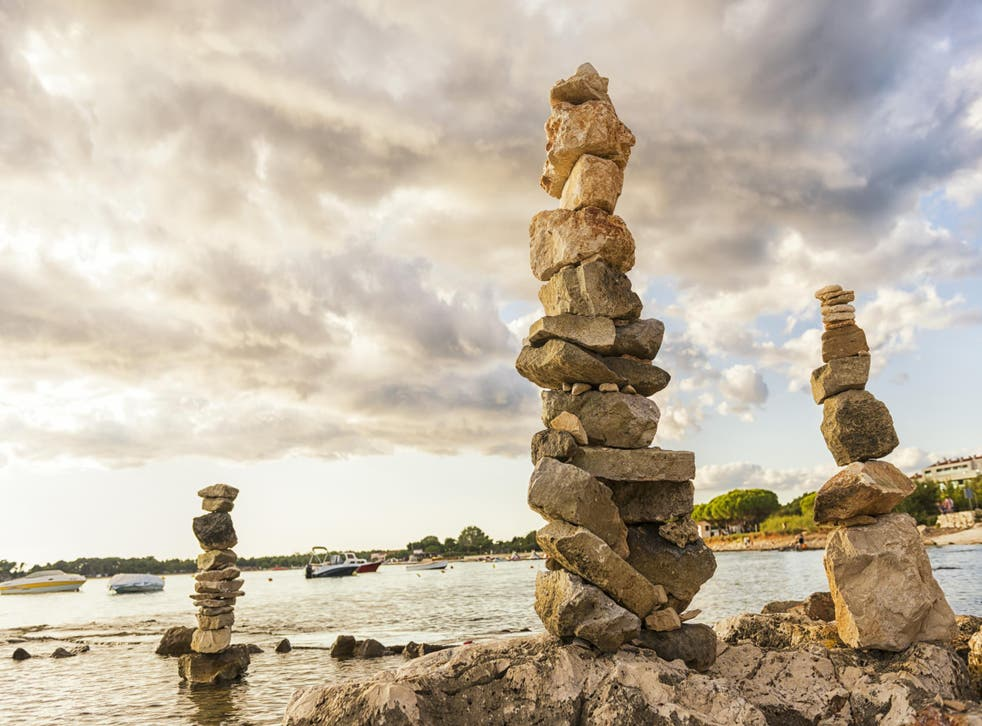 Tall piles of stacked stones may look pretty, but they could have an impact on fragile ecosystems