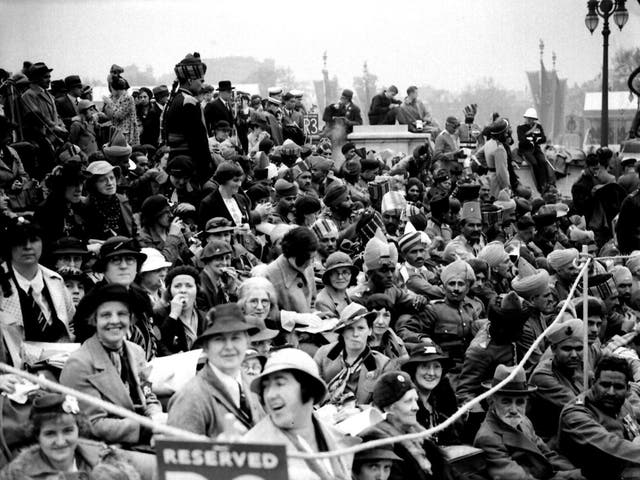 Crowds at the Queen Victoria Memorial in London celebrate the coronation of King George VI in 1937. But why were ordinary people so preoccupied with such events?