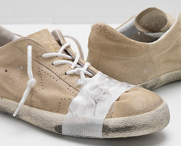 cf397824a89 Taped designer trainers heavily condemned for  mocking poverty ...