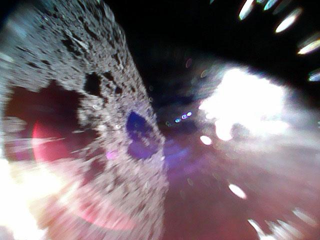 Japan's space rovers send pictures back after first ever successful landing on a...