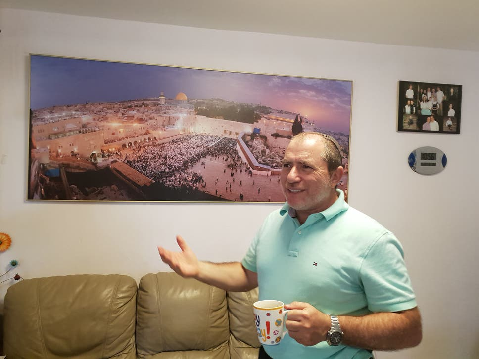 Beit El Jewish settler Chaim Silberstein stands in his home east of Jerusalem