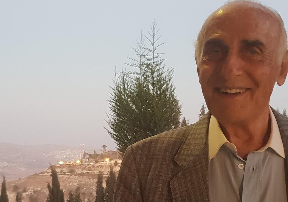 So far and yet so close: the lights of a nearby Jewish settlement shine over Munib Musri's shoulder as he stands on the edge of his vast palace of treasures near Nablus