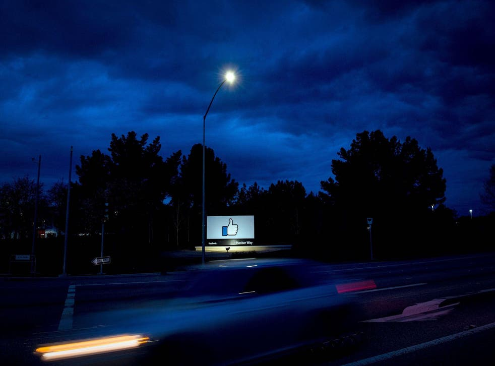 A car passes by Facebook's corporate headquarters location in Menlo Park, California, on March 21, 2018
