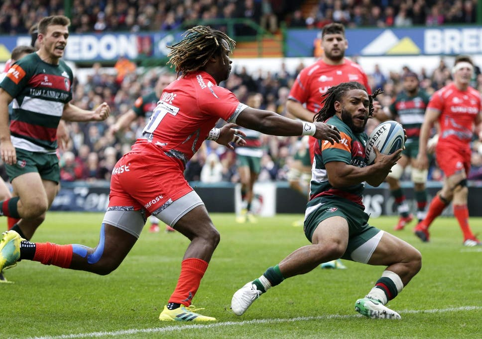 8ca5f423028 Kyle Eastmond holds off Marland Yarde to score a try for Leicester