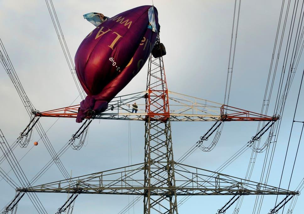 Hot air balloon crashes into electricity pylon, leaving passengers ...