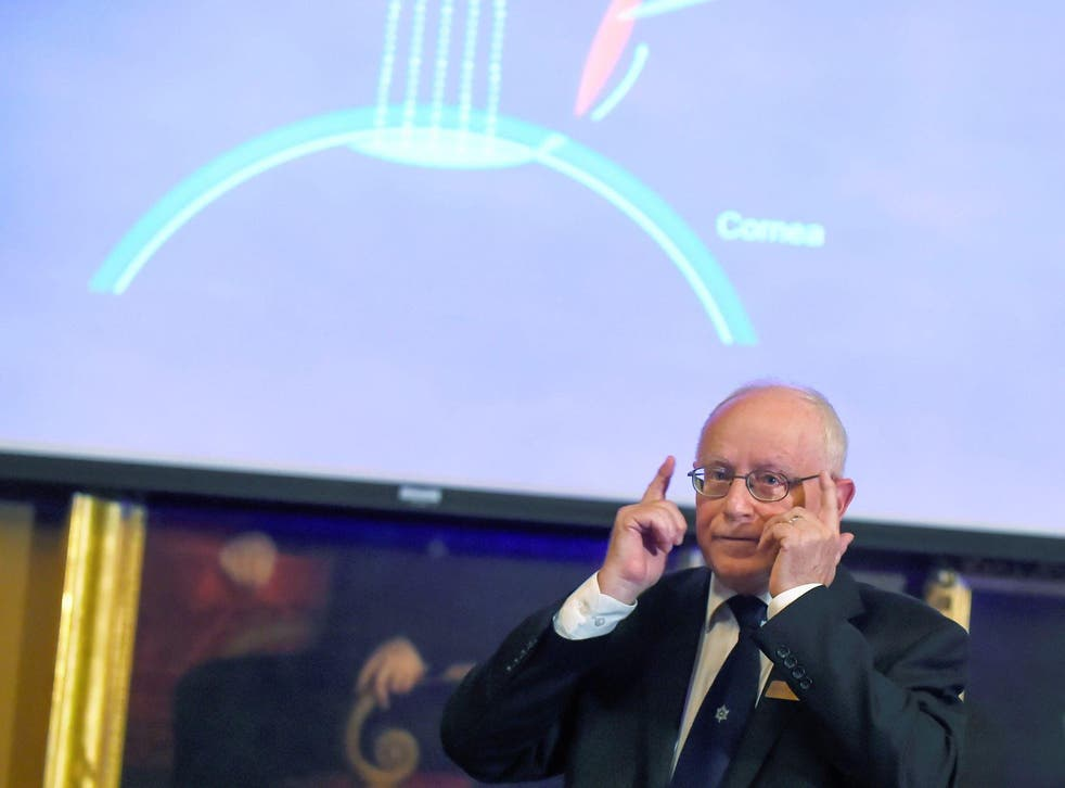 Member of the Nobel Committee for Physics Mats Larsson gives explanations on the field of research of the winners of the 2018 Nobel Prize in Physics during a press conference at the Royal Swedish Academy of Sciences on October 2, 2018 in Stockholm
