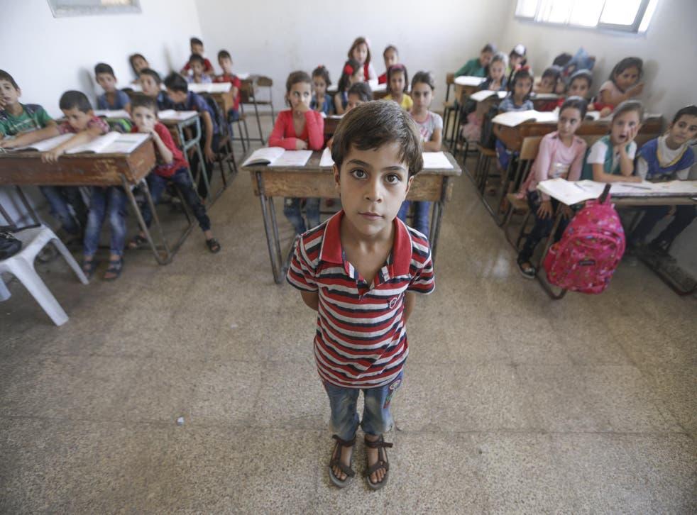 Abdullah, eight, at school in Idlib, Syria