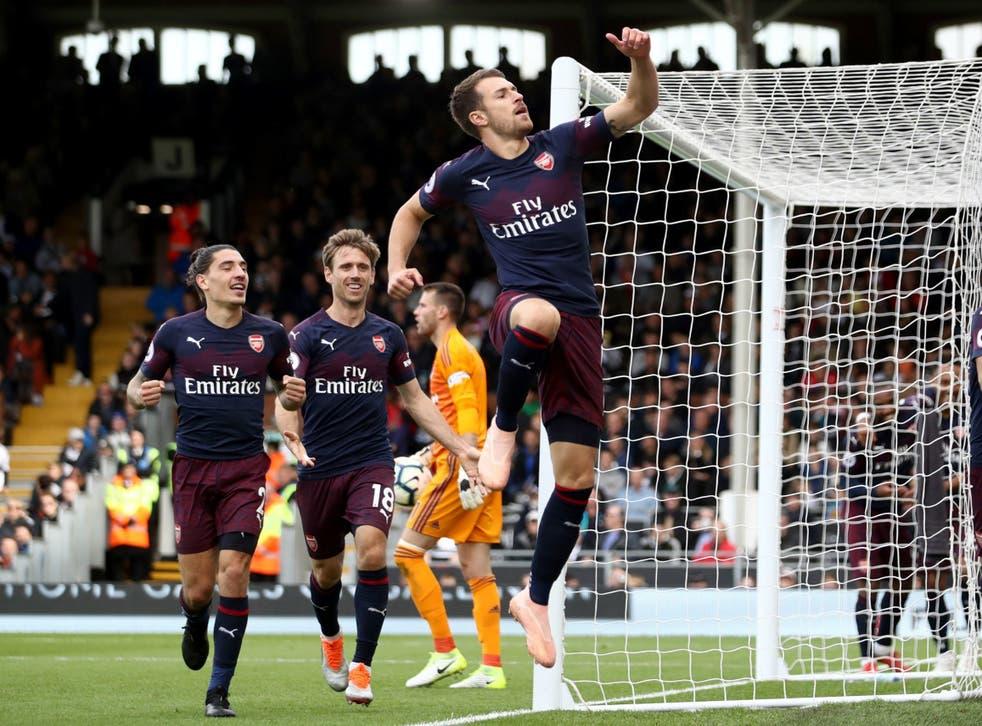 Aaron Ramsey celebrates scoring Arsenal's third goal against Fulham
