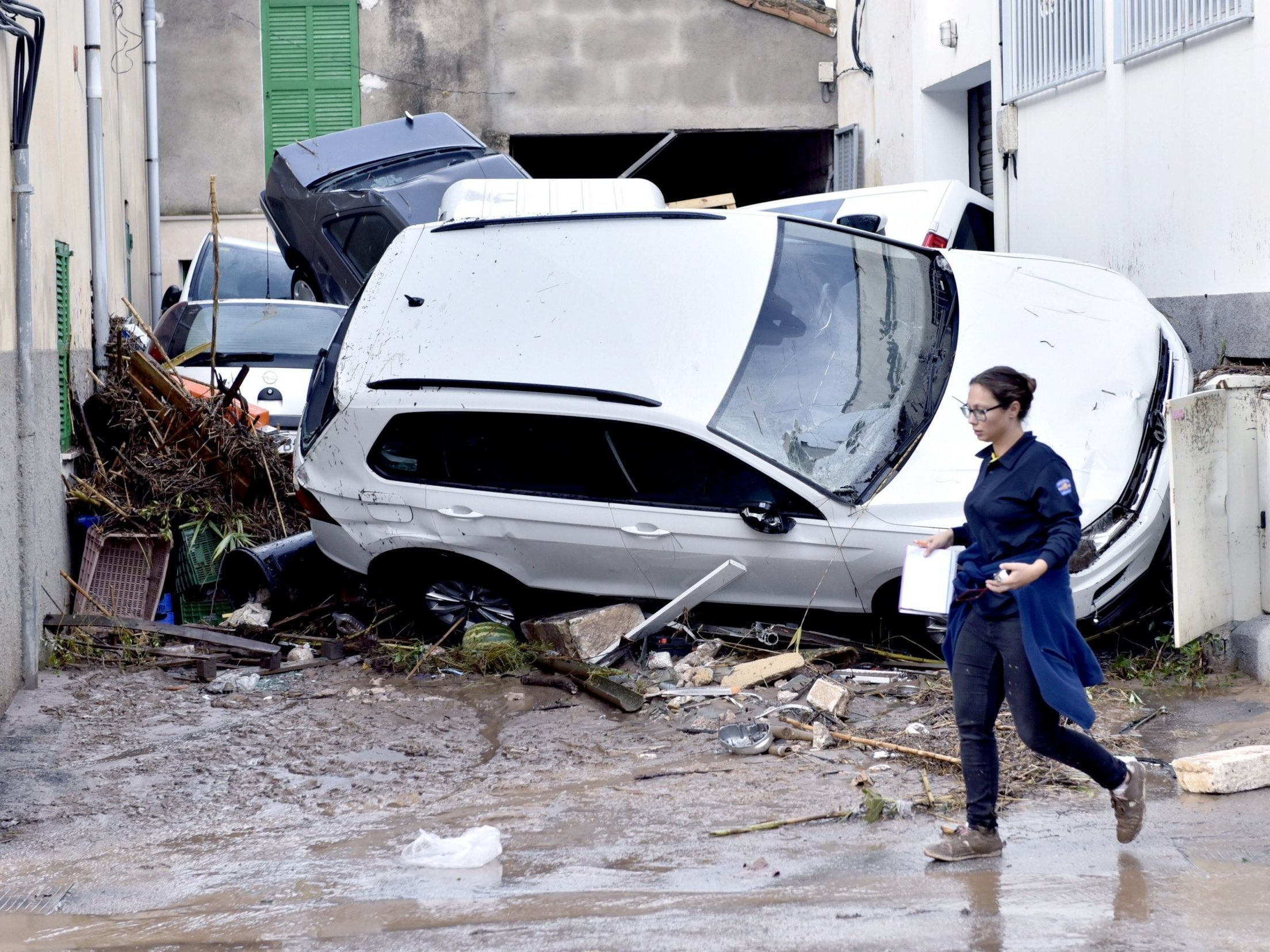 Majorca floods kill 10 as torrents sweep cars away and leave streets ...