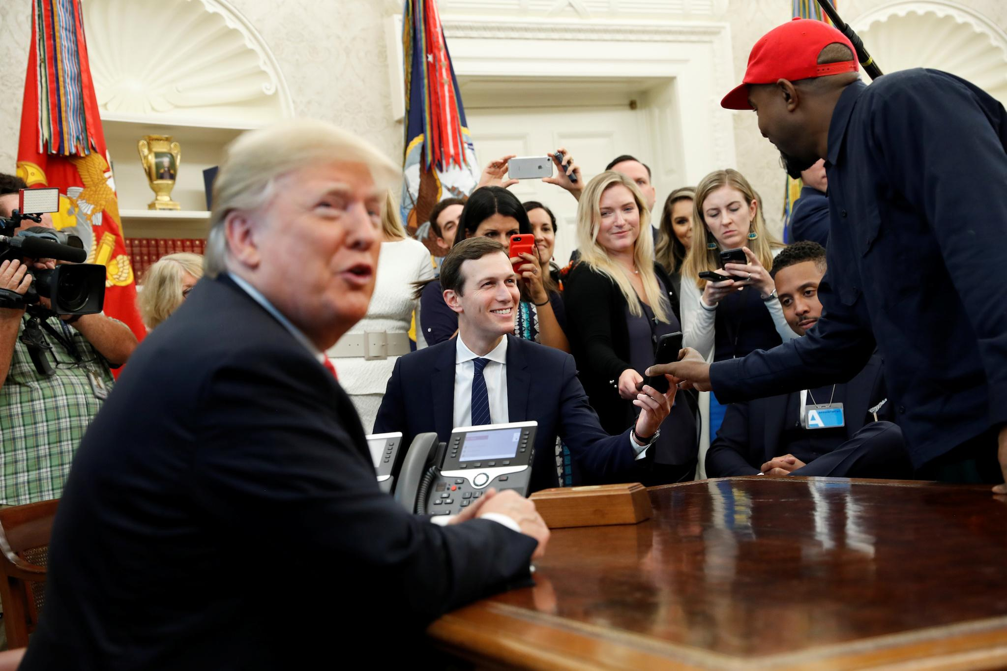Kanye West shows world his iPhone passcode during strange meeting with Donald Trump in White House