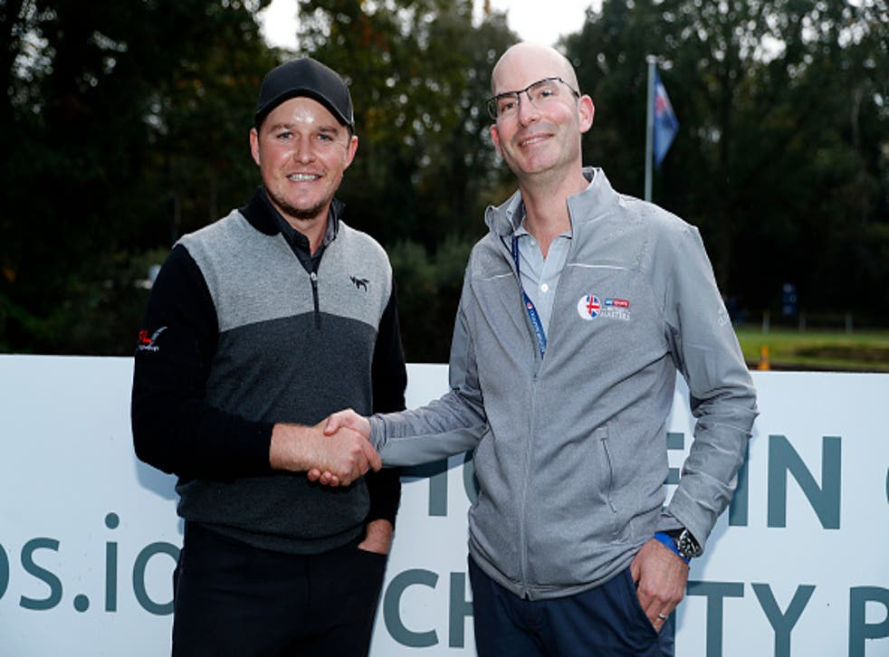 Eddie Pepperell poses with Luke Chittock after his hole-in-one