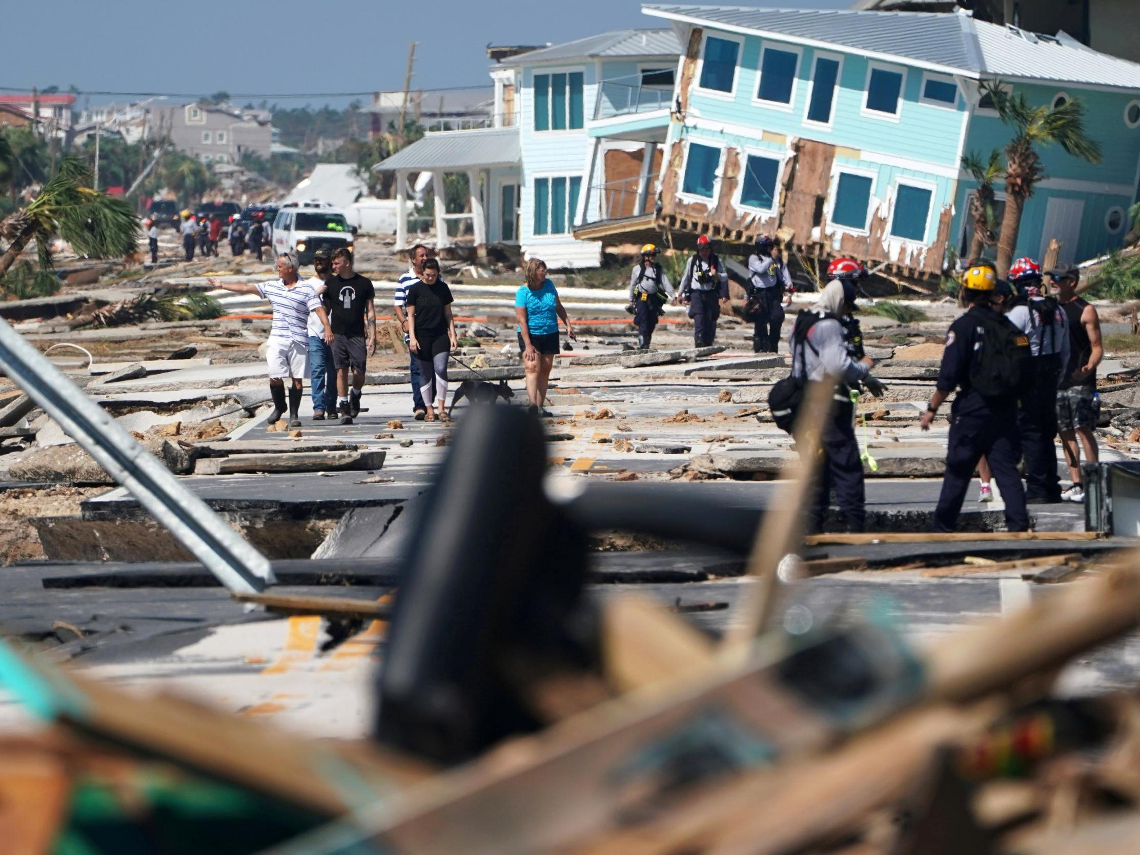 Hurricane Michael: Storm veers offshore leaving devastation and desperate rescue efforts as death toll rises