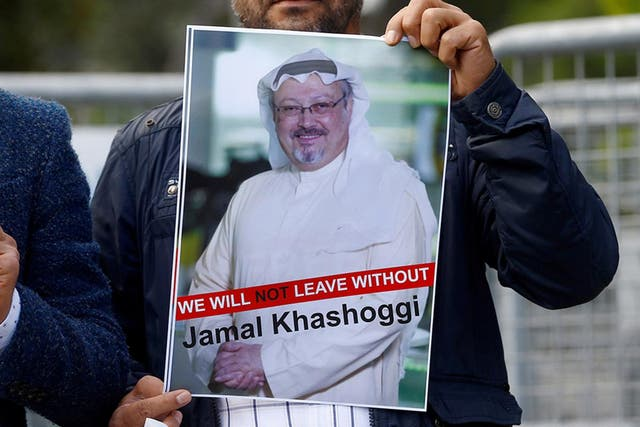 <p>Protesters in Istanbul hold a picture of the missing journalist outside the Saudi consulate</p>