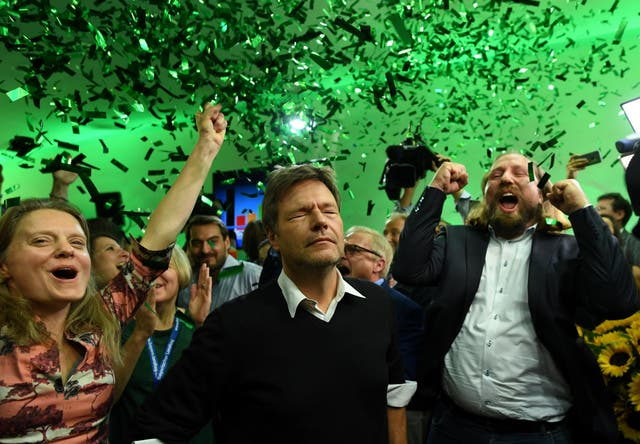 Leaders of the German Green party (Die Gruenen), Henrike Hahn, Robert Habeck and Anton Hofreiter react after to the first exit polls in the Bavarian state elections in Munich