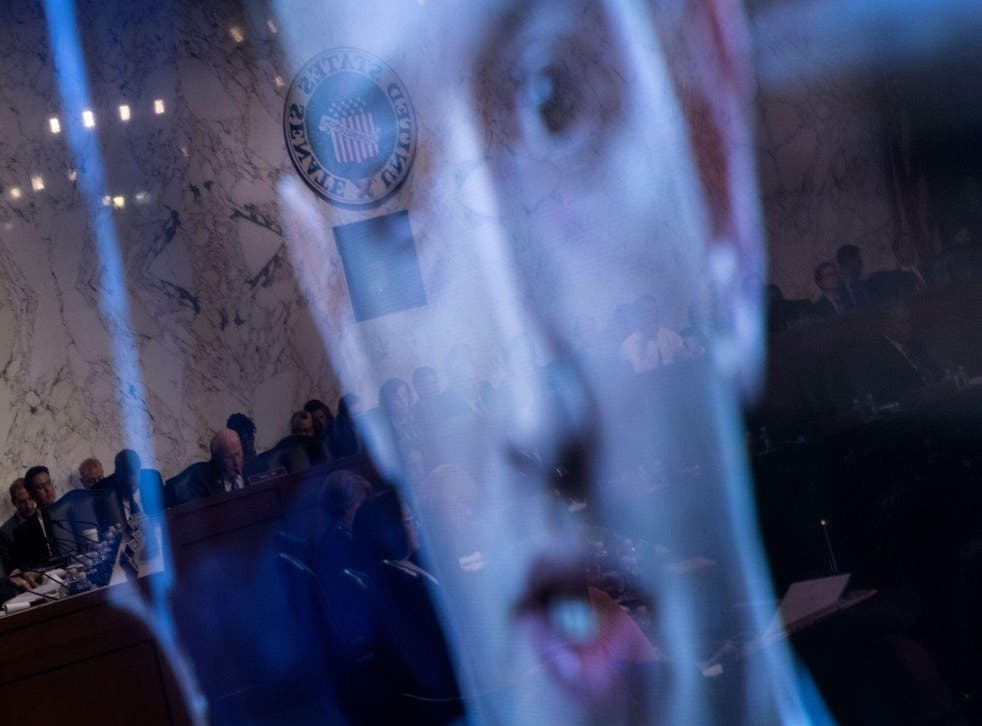 Facebook CEO Mark Zuckerberg is seen on a screen speaking during a joint hearing of the Senate Commerce, Science and Transportation Committee and Senate Judiciary Committee on Capitol Hill April 10, 2018 in Washington, DC