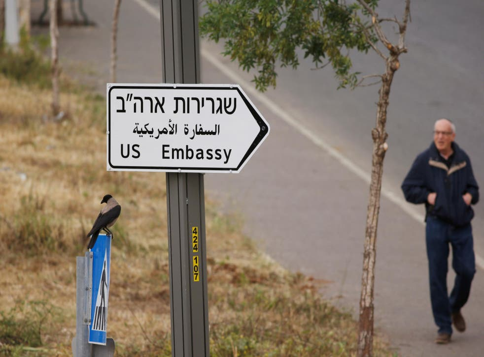 A man walks next to a road sign directing to the US embassy, in the area of the U.S. consulate in Jerusalem, May 7, 2018