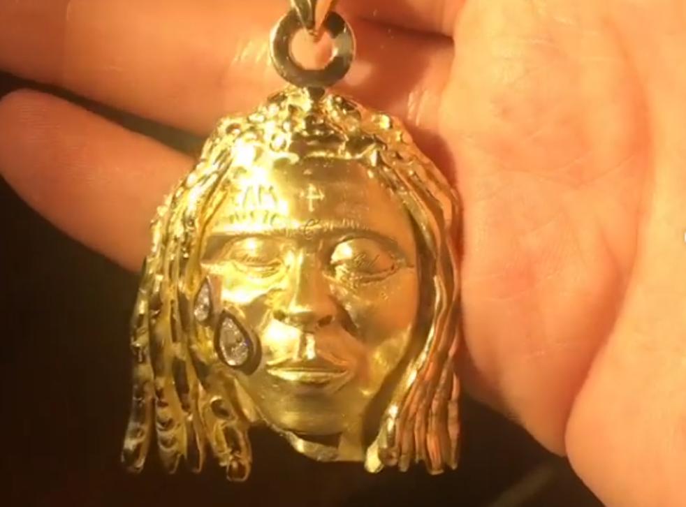 A gold pendant depicting US rapper Lil Wayne
