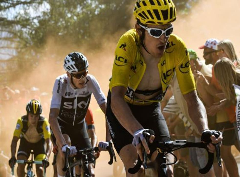 Great Britain's Geraint Thomas, right, and Great Britain's Christopher Froome, centre, during the Tour de France cycling race in 2018