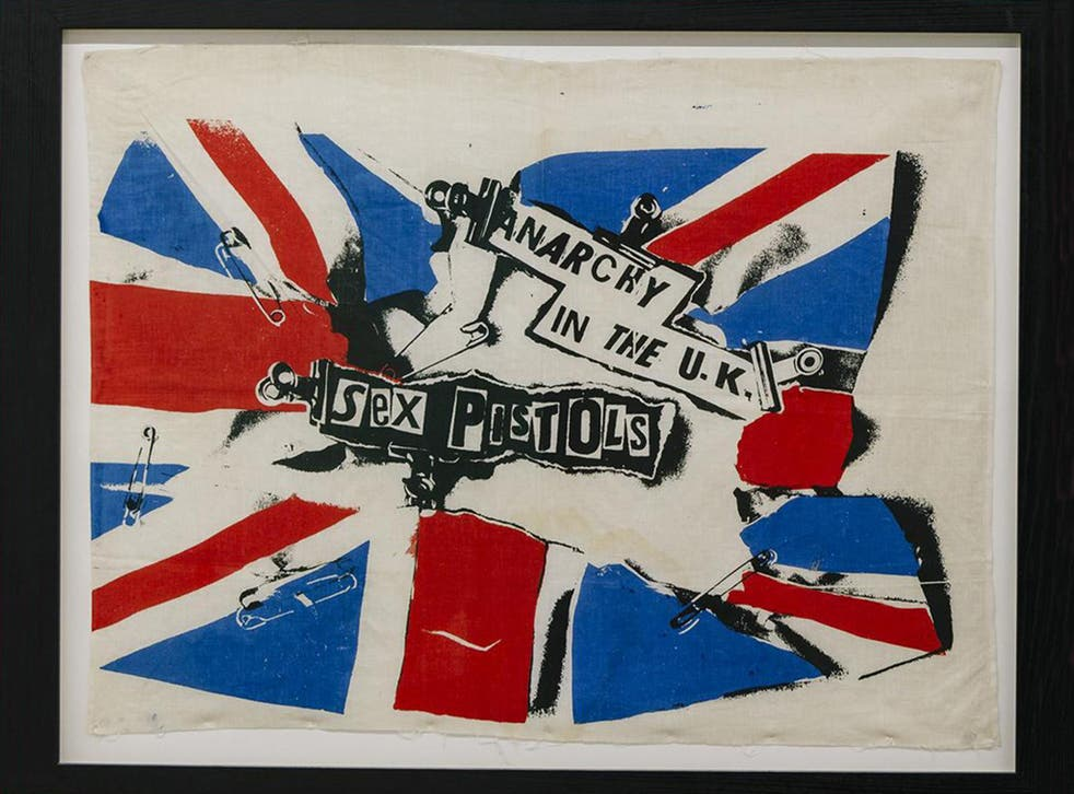 One of his irreverent posters – complete with bulldog clips and safety pins