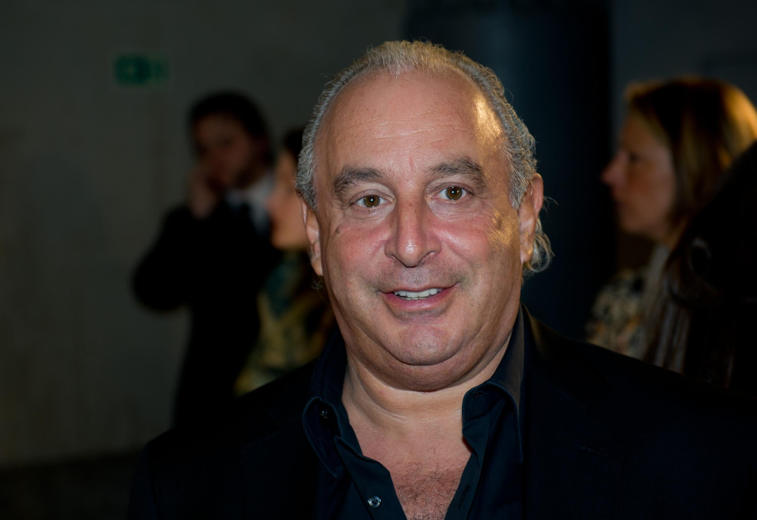 Philip Green tracked down and confronted at luxury US health resort amid sexual harassment allegations