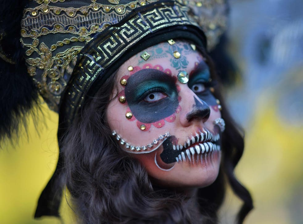 A woman in costume at Hollywood Forever Cemetery's 19th annual Día De Los Muertos event, October 27 2018