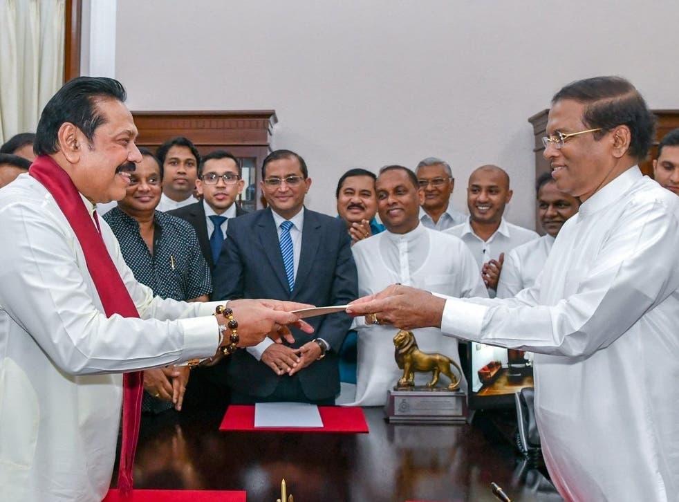 New prime minister Mahinda Rajapaksa (left) sworn in by President Maithripala Sirisena