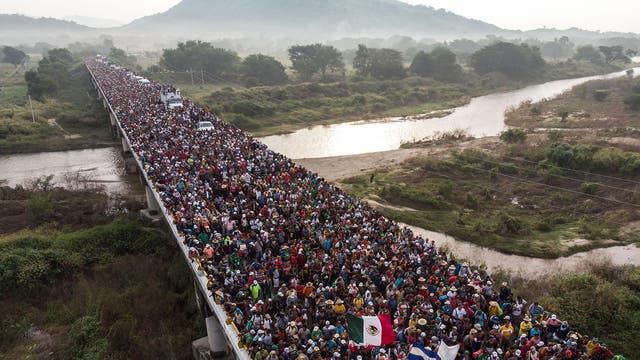 The caravan heads towards the US as they leave Arriaga in southern Mexico