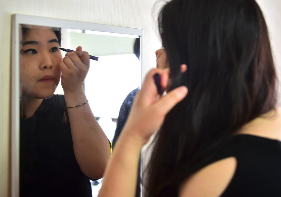 South Korean Women Destroying Makeup In Protest Against Stringent