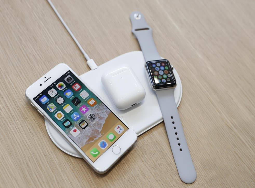 An AirPower wireless charger is displayed along with other products during an Apple launch event in Cupertino, California