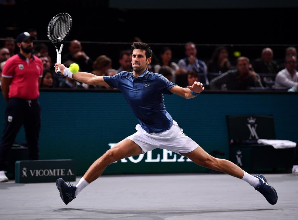 Novak Djokovic in action against Joao Sousa at the Paris Masters